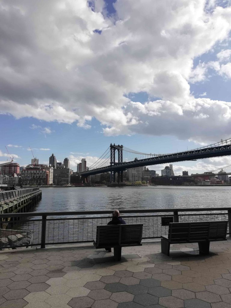 Man sitting alone at East River Park
