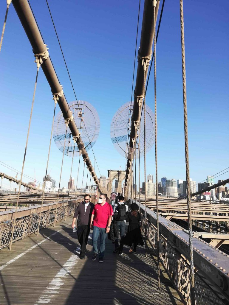 nycmoments brooklyn bridge locks walkers with masks