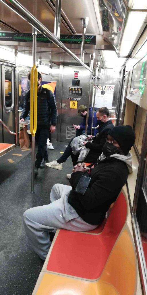 MTA subway riders wearing mask during pandemic 2020