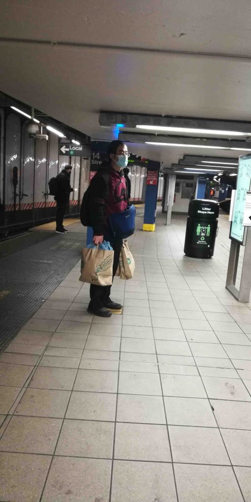 NYC Subway rider with shopping bags