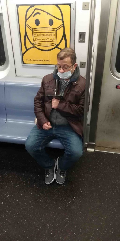 NYC Subway rider not wearing mask properly
