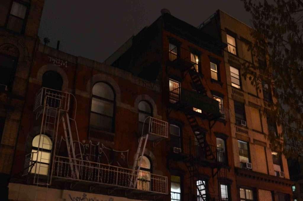 Brownstone buildings at night in NYC